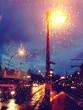 Illuminated Street Lights Seen Through Wet Glass