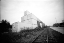 Stacked Cargo Containers By Ra...