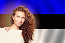 Estonia. Happy Girl Showing White Banner On Estonian Flag Background
