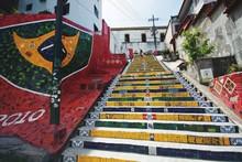 Low Angle View Of Stairs Along Graffiti Wall