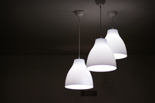 Three White Electric Light Lam...