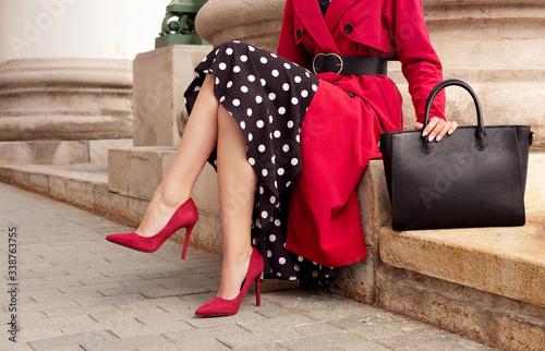 Stampa su Tela Fashionable woman in red coat, heels, black bag