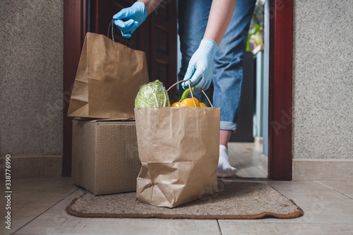 Fototapeta Coronavirus. Quarantine, contactless delivery during a pandemic covid. Stay at home, Online shopping. Food boxes and stamp. Contactless delivery. obraz