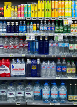 Shelves With Bottled Water In Spanish Store