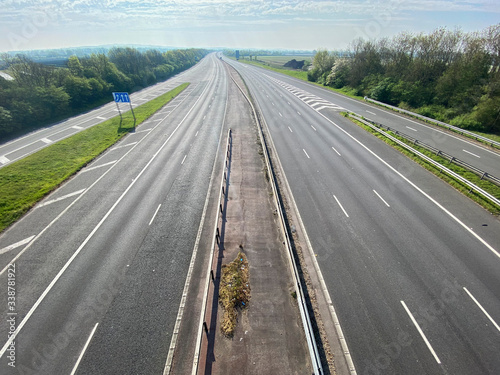 Fototapeta A motorway in the UK is deserted during the coroanvirus outbreak obraz