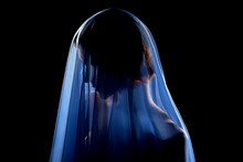 Woman Under Veil