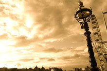 Low Angle View Of Lamp Post Against Cloudy Sky