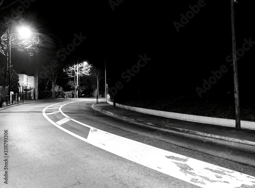 Fototapeta Illuminated Empty Road Against Clear Sky At Night obraz na płótnie