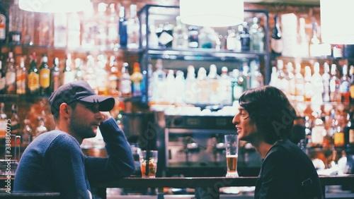 Obraz na plátně Male Friends Sitting At Bar