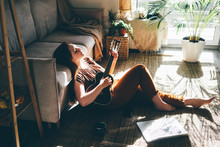 Woman Playing Music With Ukule...