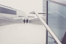 Defocused Image Of People Walking On Snow Covered Bridge During Winter