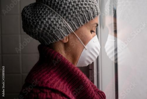 Carta da parati Woman with face masks indoors at home, Corona virus and quarantine concept