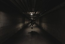 Silhouette Man Skateboarding In Tunnel