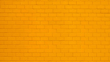 Texture Of A Orange Painted Brick Wall As A Background Or Wallpaper