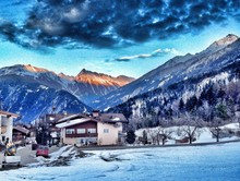 Scenic View Of Dramatic Sky Over Mountain Village