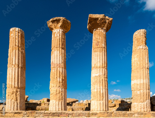 Doric columns of the Heracles temple in Agrigento with blue sky in background (S Wallpaper Mural