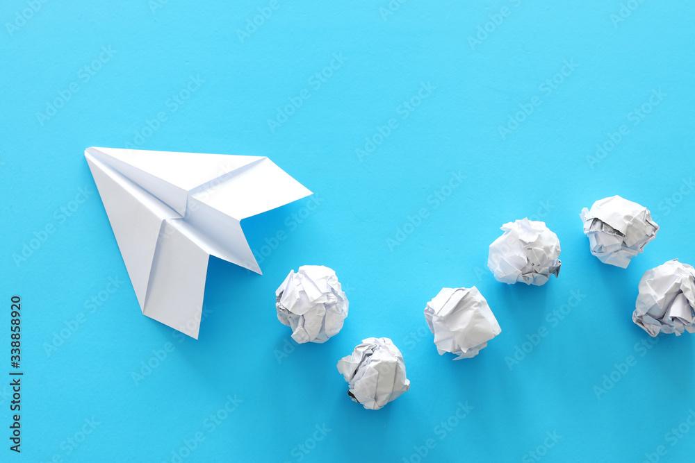 Fototapeta education or innovation concept. paper origami plane over blue background