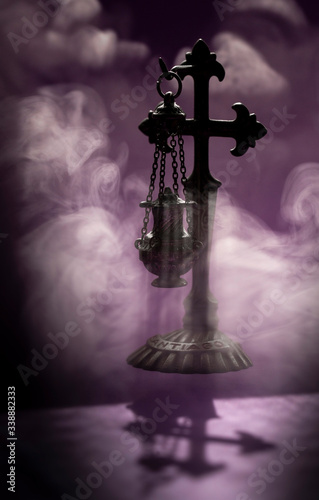 Slika na platnu Christian Church censer souvenir from Santiago de Compostela with white smoke and a purple background