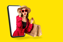 Young Attractive Asian Female Holding Shopping Bag Feeling Excited, Happy And Amaze On Beauty Or Fashion Online Store Discount Promotion With Concept Tech On Omnichannel E-commerce Thru Mobile Screen.