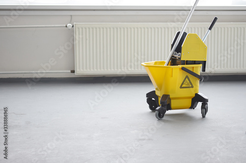 Mop and bucket, janitorial service. Fototapeta