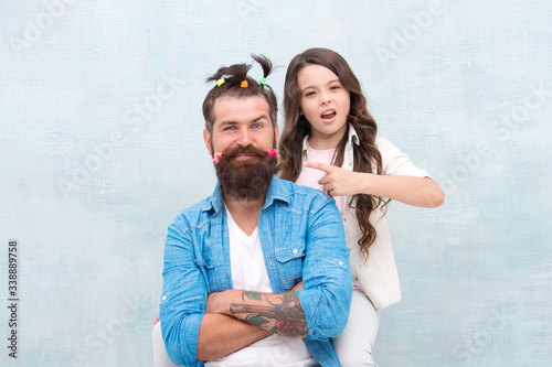 Obraz Making me happy. Daughter creating fathers hair. Handsome father with little girl. Happy father and daughter. little girl love her daddy. happy fathers day. family. Fathers day with daughter at home - fototapety do salonu