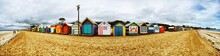 Colorful Beach Huts On Beach