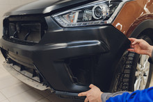 Auto Mechanic Repair Car Body Bumper Replacement.