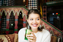 Portrait Of Happy Young Woman In A Tea Shop