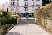 Man Walking Through Apartment ...