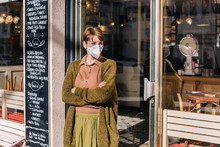Woman Wearing Mask Standing In...