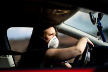 Woman In Car Wearing Respirato...