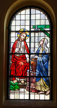 Kalety Miotek, Poland, April 7, 2020: Stained Glass Window In The Church Of St. Francis Of Assisi In Miotek In Silesia In Poland. Jesus And The Samaritan Woman,