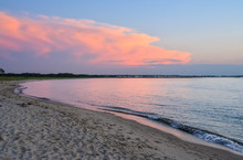 Pink Sunset View From Point At Cape Henlopen State Park Looking Toward Town In Distance