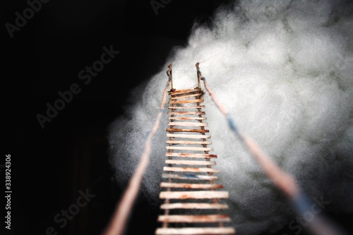 Photo Rope Bridge Leading To Cotton Cloud