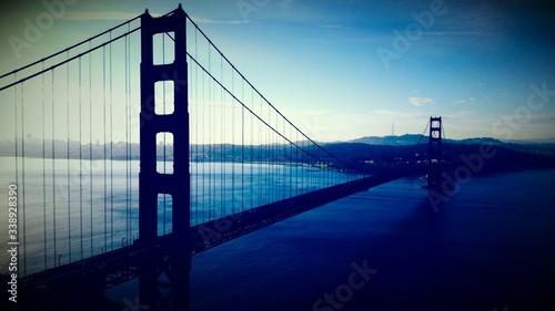 Платно Silhouette Golden Gate Bridge Over Sea Against Sky At Dusk