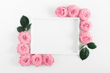 Beautiful Flowers Composition. Frame Made Of Pink Flowers On White Background. Pink Rose Pattern. Valentines Day, Birthday, Happy Women's Day, Mother's Day. Flat Lay, Top View, Copy Space