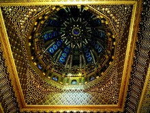 Ornate Ceiling And Stained Glass In Dome Of Temple