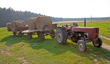 Round Hay Bales Loaded On Farm...