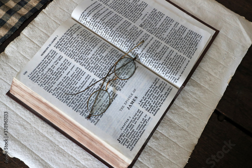 Fotografija Old Bible Epistle of James reading glasses pioneer