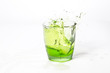 Close-up Of Splashed Drink In Glass Against White Background