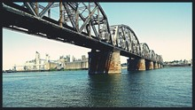 Low Angle View Of Railroad Bridge Over River
