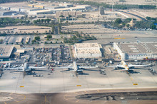 ABU DHABI, UAE - SEPTEMBER 3RD, 2017: Aerial View Of Hamad International Airport With Aircrafts On The Runway