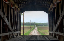 Inside A Covered Bridge, Looking Out At The Road Ahead
