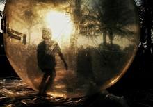 Boy Standing In Bubble In Yard