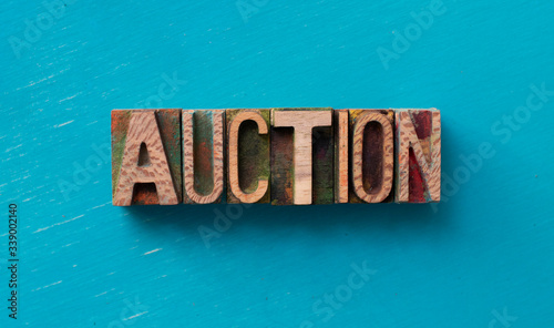 Photo Auction word written with wood type blocks