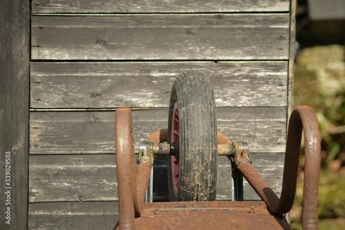 Canvas Wheelbarrow On Wooden Structure