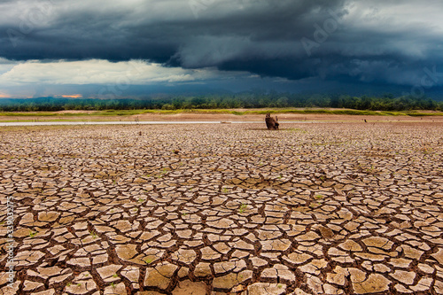 thunder storm in the sky and Cracked dry land without water Slika na platnu
