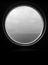 Scenic View Of Sea Seen Through Porthole