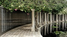 Reflection Of Colonnade In Water