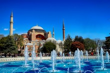 Water Fountain And Hagia Sophia Against Clear Blue Sky